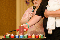 The memorial service at the Share and Care Network's annual retreat held at the Doubletree Guest Suites Hotel in Boston on May 20, 2006. <br /> <br /> The Share and Care Network was created in 1981 by Pat Cahill when her son Scott was diagnosed with Cockayne Syndrome.  A rare form of dwarfism, Cockayne Syndrome is a genetically determined condition whose symptoms include microcephaly, mental retardation, progressive blindness, progressive hearing loss, premature aging, and a shortened lifespan averaging 18 years.  Those afflicted have distinctive facial features, including sunken eyes, pinched faces, and protruding jaws as well as distinctive gregarious, affectionate personalities.<br /> <br /> Because of the rarity of the condition (1/1,000 live births) and its late onset (characteristics usually begin to appear only after one year), many families and physicians are often baffled by children whose health begins to deteriorate after normal development.  It was partly with this in mind that the Share and Care Network was formed, to promote awareness of this disease as well as to provide a support network for those families affected.  In 1998 it began organizing an annual retreat, which has grown from three families in its inaugural year to more than 30 today.  Although the retreat takes place in the United States, families from as far as Japan arrive for this one weekend out of the year to share information and to support one another.