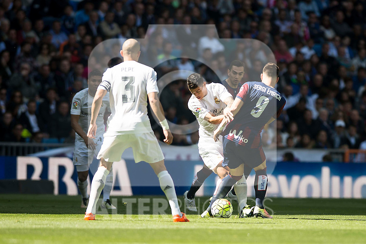 Real Madrid's James Rodriguez and Pepe and Sociedad Deportiva Eibar's Sergi Enrich during La Liga match. April 09, 2016. (ALTERPHOTOS/Borja B.Hojas)