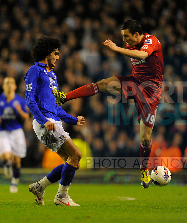Stewart Downing of Liverpool goes in high on Marouane Fellaini of Everton.Barclays Premier League match between Liverpool v Everton at Anfield, Liverpool on the 13th March 2012..Sportimage +44 7980659747.picturedesk@sportimage.co.uk.http://www.sportimage.co.uk/.