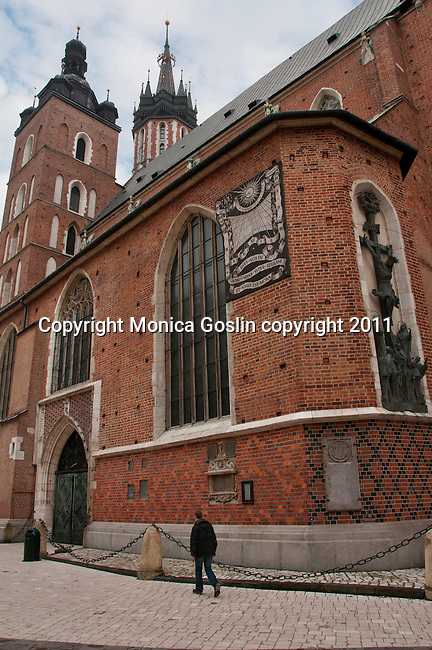 St. Mary's Basilica in Krakow, Poland. St. Mary's Basilica sits on the Main Market Square, and was first built in the 13th century