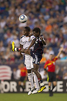 Los Angeles Galaxy forward Edson Buddle (14) and New England Revolution defender Emmanuel Osei (5) battle for head ball. The New England Revolution defeated LA Galaxy, 2-0, at Gillette Stadium on July 10, 2010.
