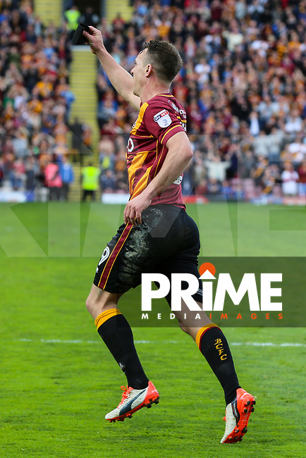 Tony McMahon of Bradford City celebrates scoring the first goal of the game from the penalty spot during the Sky Bet League 1 match between Bradford City and AFC Wimbledon at the Northern Commercial Stadium, Bradford, England on 22 April 2017. Photo by Thomas Gadd.