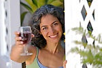 Mature woman toasting with wineglass, smiling
