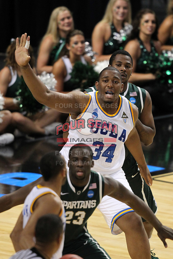 UCLA Bruins Joshua Smith #34 fights for position during the second round game of the NCAA Basketball Tournament at St. Pete Times Forum on March 17, 2011 in Tampa, Florida.  UCLA defeated Michigan State 78-76.  (Mike Janes/Four Seam Images)