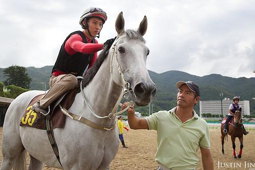 Winning Hong Kong jockey Matthew Chadwick rides California Memory at the Hong Kong Jockey Club. Renowned trainer Tony Cruz pulls the horse.