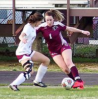 Westside Eagle Observer/RANDY MOLL<br /> Gentry senior Katie Ellis moves the ball past a Huntsville defender in Gentry on March 3.