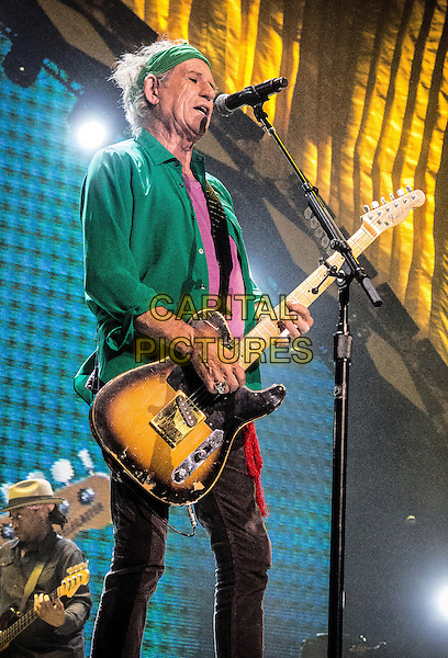 Keith Richards<br /> The Rolling Stones &quot;50 &amp; Counting&quot; Tour live at TD Garden, Boston, Massachusetts, USA 14th June 2013<br /> on stage in concert live gig performance performing music half length purple top guitar green bandana singing<br /> CAP/ADM/RP<br /> &copy;Randy PollickAdMedia/Capital Pictures