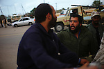 Sirte, LIBYA: Monday 11th October 2011:..A rebel soldier shouts at a man suspected of being a Gaddafi loyalist soldier on the back of a pickup truck leaving Sirte..Ayman Oghanna