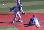 Wildcats' Brogan Secrist dives into second base against the tag of Salt Lake Community College's Skyler Mahoney during a college baseball game at Western Nevada College in Carson City, Nev., on Thursday, March 5, 2015. <br /> Photo by Cathleen Allison/Nevada Photo Source
