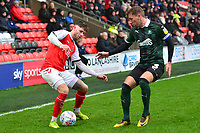 Fleetwood Town's Wes Burns vies for possession with Plymouth Argyle's Gary Sawyer<br /> <br /> Photographer Richard Martin-Roberts/CameraSport<br /> <br /> The EFL Sky Bet League One - Fleetwood Town v Plymouth Argyle - Saturday 16th March 2019 - Highbury Stadium - Fleetwood<br /> <br /> World Copyright © 2019 CameraSport. All rights reserved. 43 Linden Ave. Countesthorpe. Leicester. England. LE8 5PG - Tel: +44 (0) 116 277 4147 - admin@camerasport.com - www.camerasport.com