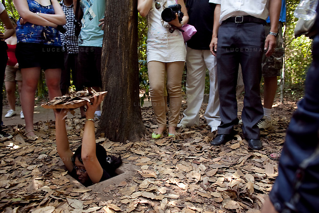 Tourists visit the Cu Chi Tunnels in Cu Chi, Vietnam.