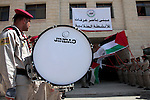 Palestinian scouts hold their national flag as Palestinian prime minister Salam Fayyad attends the opening ceremony during the inauguration of Yasser Arafat Building at Hebron University in the Palestinian city of Hebron in the West Bank on May 30, 2011.Photo by Najeh Hashlamoun