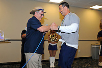 12 August 2011:  FIU President Mark Rosenberg introduces Football Head Coach Mario Cristobal during the FIU 2011 Panther Preview at University Park Stadium in Miami, Florida.