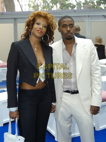 KELIS & NAS.Glamour Magazine's Women Of The Year Awards. Berkeley Square Gardens, London, W1.June 8th, 2004.half length, half-length, white pinstripe suit, plunging neckline, cleavage, hoop earrings.www.capitalpictures.com.sales@capitalpictures.com.©Capital Pictures