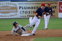 Center fielder Tyler Naquin (6) of the Carolina Mudcats is out attempting to steal second with Jason Martinson (11) of the Potomac Nationals making the tag on Friday, June 21, 2013, at G. Richard Pfitzner Stadium in Woodbridge, Virginia. Naquin was taken by the Cleveland Indians in the first round of the 2012 First-Year Player Draftand is the Indians' No. 3 prospect. Potomac won, 5-1. (Tom Priddy/Four Seam Images)
