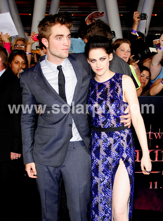 "**ALL ROUND PICTURES FROM SOLARPIX.COM**                                             **SYNDICATION RIGHTS FOR UK, AUSTRALIA, DENMARK, PORTUGAL, S. AFRICA, SPAIN & DUBAI (U.A.E) & ASIA (EXCLUDING JAPAN) ONLY**                                                                                   Arrivals for ""The Twilight Saga: Breaking Dawn Part 1"" Los Angeles Premiere at the Nokia Theatre L.A.                                                                            This pic:     Robert Pattinson and Kristen Stewart                                                                                 JOB REF:   14188     PHZ evans       DATE:  15.11.11                                                          **MUST CREDIT SOLARPIX.COM OR DOUBLE FEE WILL BE CHARGED**                                                                      **MUST AGREE FEE BEFORE ONLINE USAGE**                               **CALL US ON: +34 952 811 768 or LOW RATE FROM UK 0844 617 7637**"
