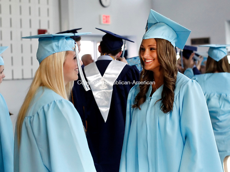 Oxford, CT- 17 June 2014-061714CM03-  Oxford High School graduates, Riley McEwen, left, and Brooke Kuzma share a laugh before the start of commencement exercises at Oxford High School on Tuesday.    Christopher Massa Republican-American