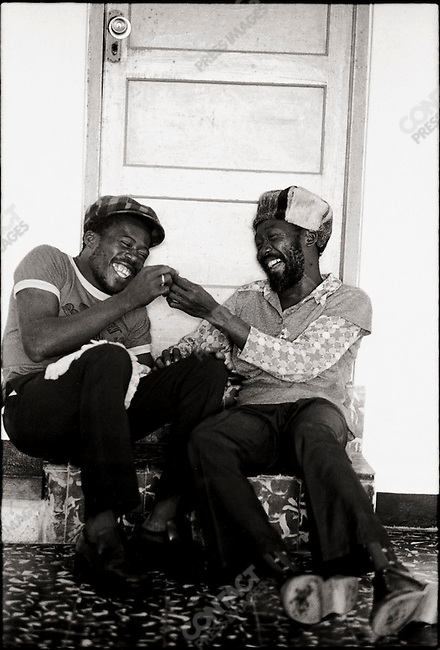 """Noel """"Zoot"""" or """"Scully"""" Simms and Lee """"Milo"""" Spence at Jack Ruby's in Ocho Rios. Kingston, Jamaica. March 1976"""