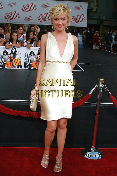 """ARIELLE KEBBEL.""""John Tucker Must Die"""" Los Angeles Premiere held at Mann's Grauman Chinese Theater, Hollywood, California, USA..July 25th, 2006.Photo: Charles Harris/AdMedia/Capital Pictures.Ref: CH/ADM.full length white sleeveless satin dress clutch purse plunging neckline.www.capitalpictures.com.sales@capitalpictures.com.©AdMedia/Capital Pictures."""
