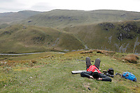 Plane spotter on a hill called Cad West wait for airplanes. The 'Mach Loop' is the nick name of an area in Wales used for low flying by the Royal Air Force. The proximity to the aircraft has made the area popular with plane spotters who come to see and photograph the aircraft.