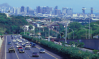 H1 freeway with traffic and Honolulu buildings in the rear