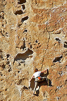 Rock climber going up rock face. Smith Rock State Park. Central Oregon