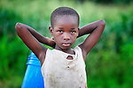A girl carries a bucket to fetch water for her family in Karonga, a town in northern Malawi.