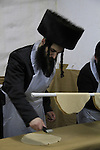 Matzah baking ahead of the Seder meal at the Hasidic Premishlan congrgation, preparation of the dough