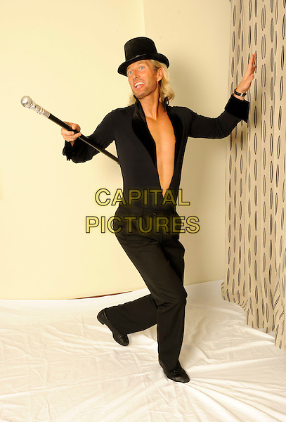 Robbie Savage .studio session, London, England 29th September 2011.**EXCLUSIVE ALL-ROUNDER**.full length topless chest black top hat shirt trousers cane dancing .CAP/FIN.©Steve Finn/Capital Pictures........THIS IS A SPEC PICTURE>FEE REQUIRED FOR USEAGE.CAP/FIN.©Steve Finn/Capital Pictures.