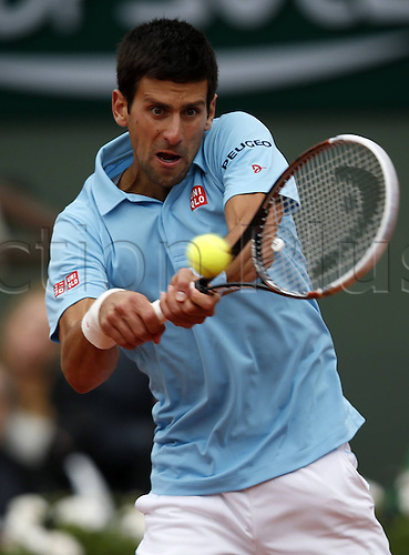 28.05.2014. Roland garros, Paris, France. French Open tennis tournament. Novak Djokovic of Serbia returns the ball during the mens singles match