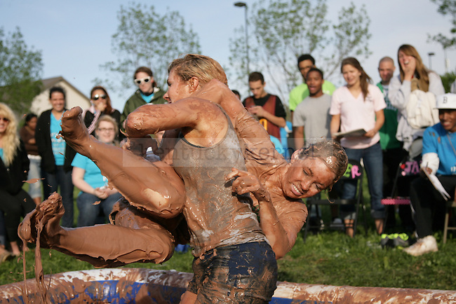Sorority members wrestle in the pudding wrestling tournament in the semi-finals of the pudding wrestling tournament during the 17th annual PiAthon Thursday, April 5, 2012 at Good Barn field in Lexington, Ky. Photo by Brandon Goodwin | Staff
