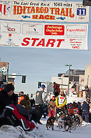 Musher Trent Herbst and Iditarider Sam Anderson.leave the 2011 Iditarod ceremonial start line in downtown Anchorage, Alaska