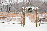 63821-174.07 Rustic fence & arbor with holiday wreath near prairie in winter, Marion Co. IL