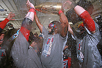 (Boston, MA  10/30/2013)  Red Sox David Ortiz celebrates with an expensive and large bottle of champagne after clinching in Game 6 of the World Series at Fenway Park on Thursday, October 30, 2013. Staff Photo by Matt West.