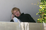 .3-14-09 Exclusive.Owen Wilson hanging out talking on the phone with his dog in Santa MOnica ca ..AbilityFilms@yahoo.com.805-427-3519.www.AbilityFilms.com