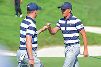 Rickie Fowler (USA) and Justin Thomas (USA) fist bump after going up another one at 5 during round 1 foursomes of the 2017 President's Cup, Liberty National Golf Club, Jersey City, New Jersey, USA. 9/28/2017.<br /> Picture: Golffile | Ken Murray<br /> ll photo usage must carry mandatory copyright credit (&copy; Golffile | Ken Murray)