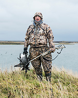 Outdoor Life Editor John Snow hunting brant in Cold Bay, Alaska, Wednesday, November 2, 2016. The Izembek National Wildlife Refuge lies on the northwest coastal side of central Aleutians East Borough along the Bering Sea. Birds hunted include the long tailed duck, the Steller's Eider, the Harlequin, the King Eider and Brant.<br /> <br /> Photo by Matt Nager