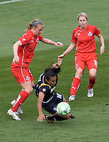 LA Sol's Marta is tripped up by Washington Freedom's Becky Sauerbrunn and the defense. The LA Sol defeated the Washington Freedom 2-0 in the opening game of Womens Professional Soccer at Home Depot Center stadium on Sunday March 29, 2009.  .Photo by Michael Janosz