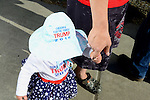 """Trump's going to be the strongest for veterans and keep out drugs,"" said Clay of Ferndale, holding the hand of his 14-month-old daughter, Liberty, while waiting in line for a campaign stop and rally by Republican Presidential Candidate Donald Trump in Lynden, Washington at the Northwest Washington Fairgrounds Saturday May 7, 2016. Photo by Daniel Berman/www.bermanphotos.com"
