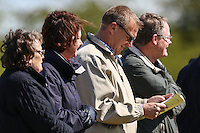 Former Premier League referee, Graham Poll (3rd left), reads the match day programme during the Bedfordshire County Football League match between Ampthill Town U18 and Renhold United Reserves at Shefford Sports Club, Shefford, England on 30 April 2016. Photo by David HornPRiME Media Images.