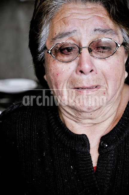 Chile, Aftermath of the tsunami in the area of Consitucion. Rosa Mirta Jeramillo (73)