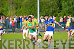 Glenflesk's unstoppable Jeff O'Donoghue is going for the goal while Finuge's Paul Galvin trying to challenge.