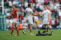 A dejected George Ford of England shakes hands with team mate Jack Clifford despite winning the Old Mutual Wealth Cup match between England and Wales at Twickenham Stadium on Sunday 29th May 2016 (Photo: Rob Munro/Stewart Communications)