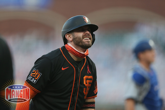 SAN FRANCISCO, CA - AUGUST 27:  Evan Longoria #10 of the San Francisco Giants reacts after fouling a ball off his foot against the Los Angeles Dodgers during game two of a doubleheader at Oracle Park on Thursday, August 27, 2020 in San Francisco, California. (Photo by Brad Mangin)
