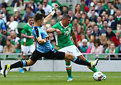 June 4th 2017, Aviva Stadium, Dublin, Ireland; International Friendly, Ireland versus Uruguay;  Jonathan Walters of Ireland is tackled by Sebastián Coates of Uruguay