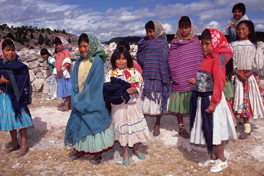 Tarahumara Indian children gathered outside at San Ignacio Arareco Mission school. Copper Canyon, Mexico.