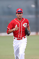 Jose Siri (4) of the AZL Reds returns to the dugout during a game against the AZL Brewers at Cincinnati Reds Spring Training Complex on July 5, 2015 in Goodyear, Arizona. Reds defeated the Brewers, 9-4. (Larry Goren/Four Seam Images)