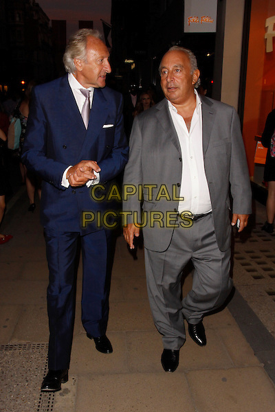 Harold Tillman and Sir Philip Green.Fashion's Night Out, Bond Street, London, England..6th September, 2012.full length white shirt blue suit purple tie grey gray profile .CAP/AH.©Adam Houghton/Capital Pictures.