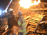 Palisades football captains light the bonfire during a pep rally to cheer on the Palisades High School football team Thursday, November 16, 2017 at Palisades Middle School in Kintnersville. Palisades, 11-0 this season, will be playing Lehighton on Saturday for the PIAA District 11 Class 3A title at Bethlehem School District Stadium. (Photo by William Thomas Cain)