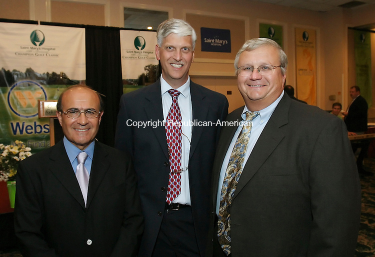 WATERBURY,  CT 12 September 2005 -091205BZ13-  From left-  Dr. Aziz Richi, of Middlebury, a surgeon at St.Mary's; Dr. Bill Frederick, of Cheshire, chairman of pathology at St.Mary's; and Dr. Mitch Chere, an OB-GYN at St.Mary's;<br /> <br /> during the Saint Mary's Hospital 10th Annual Champion Golf Classic &quot;Dinner of Champions&quot; Monday night.<br />  Jamison C. Bazinet / Republican-American